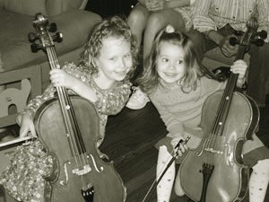 young girls having fun with cello